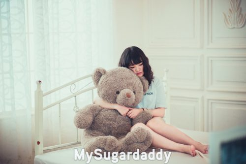 sufferer of philophobia hugging huge teddy bear