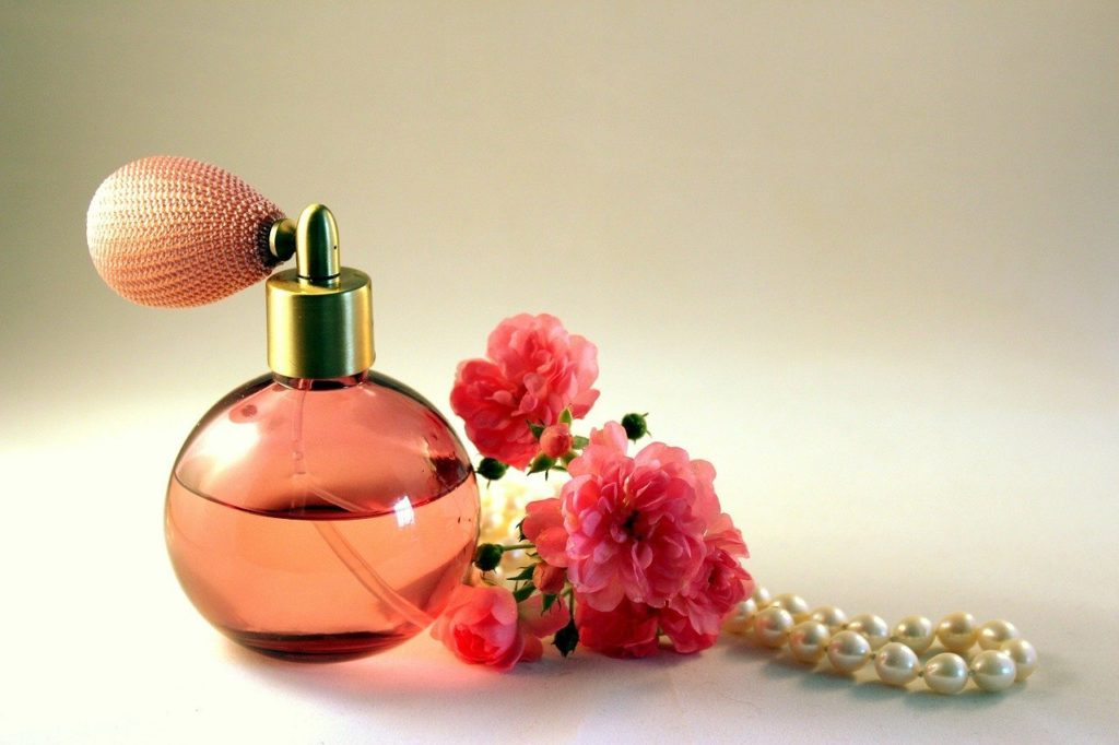 bottle of perfume and flowers