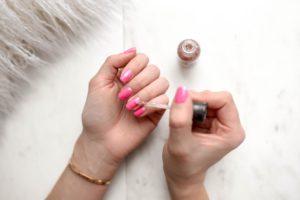 girl doing her nails