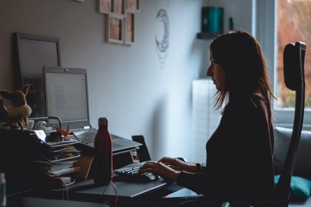 woman sitting in front of laptop in a way that prevents most cvs symtoms