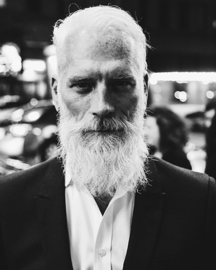 man with white beard and hair in his 40s