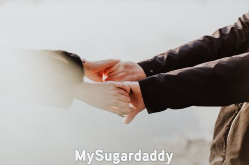 girl holding hands with her platonic sugar daddy