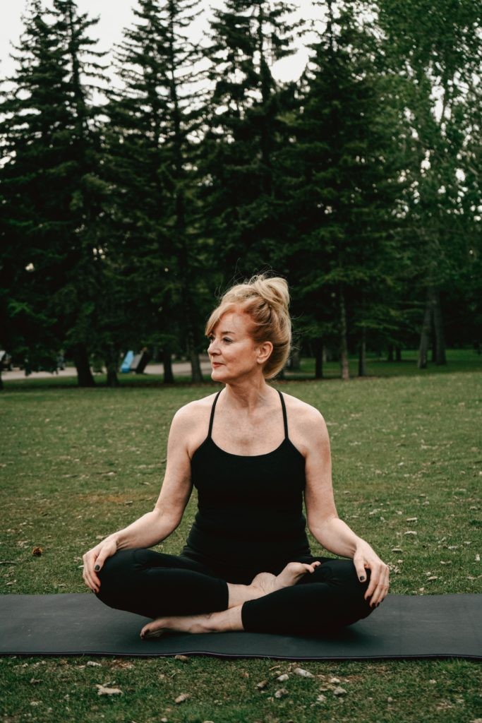 woman on yoga mat at class for pelvic floor exercise