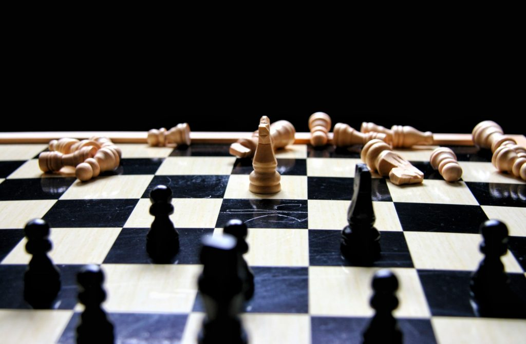 chess board symbolizing that compromise is a win-lose