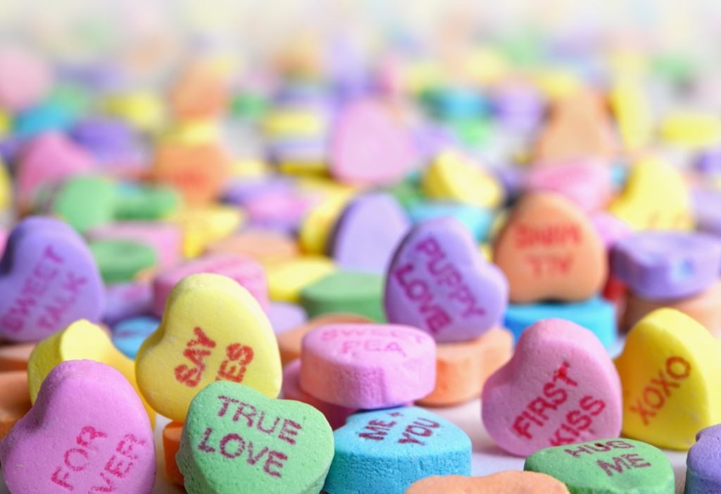 symbol of old-school dating: candy with messages on it