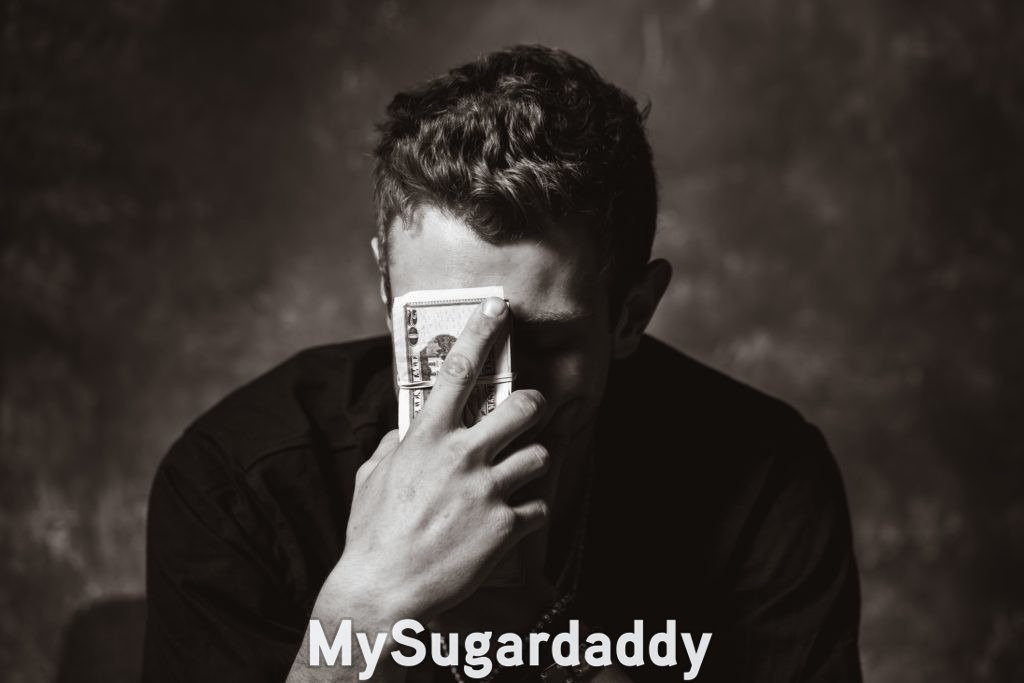 sugar daddy frustratingly holding money to his face because the relationship feels transactional