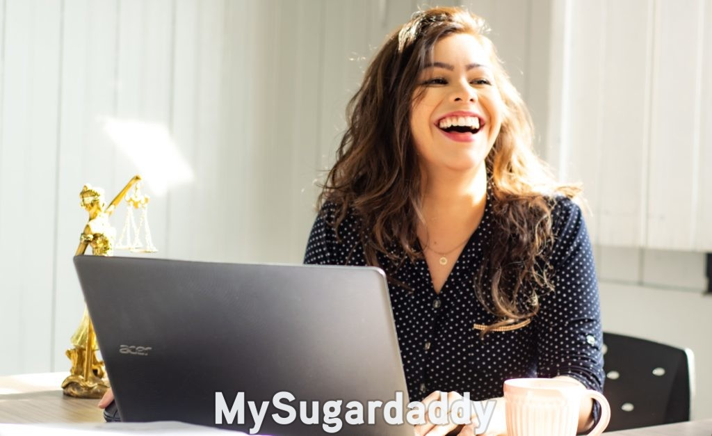 sugar daddy scam: woman smiling after recognizing it